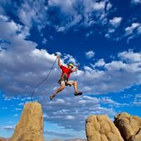 Climber jumping a gap